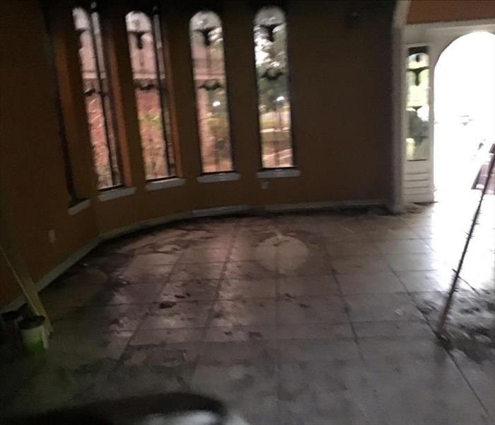 Customers Entire Tire Flooring In Living Room Covered in Black Soot