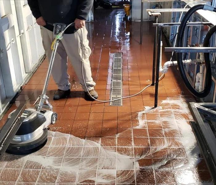 Flooring being cleaned and Waxed with cleaning machine