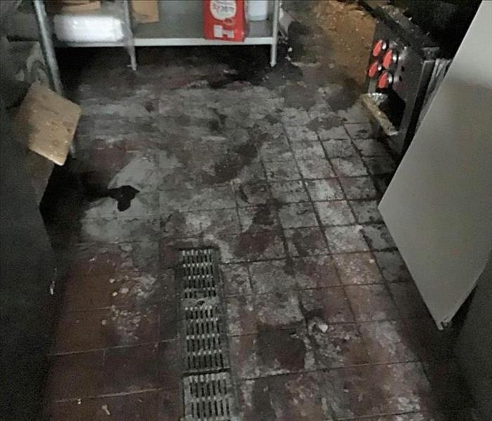 Flooring Damaged with soot after a Fire