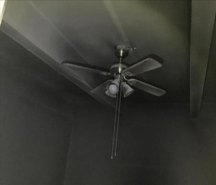 Smoke and Soot Damage on ceiling and fan