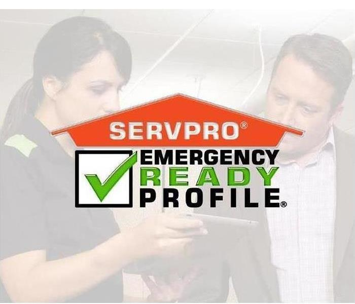 SERVPRO Technician Showing a business owner our mobile ERP App