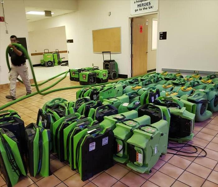 green SERVPRO equipment lining the floor