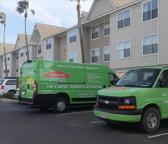 Green SERVPRO Trucks Parked Outside Customers Home